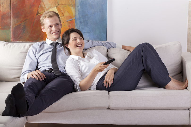 Couple lounging comfortably at home